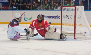 photo by Katie Harris Wounded Warrior Project veteran, Joshua Sweeney, scores the only, and winning, goal during the USA vs. Russia gold medal Sled Hockey game during the 2014 Winter Paralympics in Sochi, Russia.