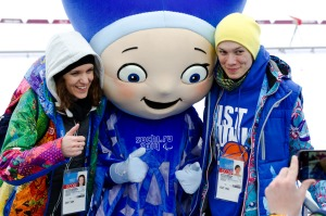 photo by Katie Harris A Sochi 2014 mascot poses with volunteers at the Biathalon course.