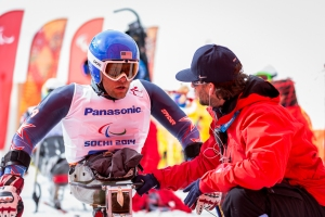 US Coach Kevin Jardine discusses strategy with US downhill racer Tyler Walker before his run