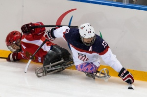 photo by Ken King Wounded Warrior Project veteran, Joshua Sweeney, takes the puck from Russia in the gold medal game during the 2014 Winter Paralympics in Sochi.
