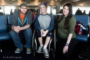 photo by Ken King Wheelchair Sports Federation media volunteers; (left to right) Matt Gephart, Eric Gissendanner, and Katier Harris; travelling to Sochi for the 2014 Winter Paralympics