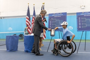 Photo by Michael A. Clubine US Open Refferee, Brian Earley, announces as under-20 USTA member, Nate Melnyk, draws names for the US Open wheelchair tennis games.