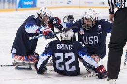 Team USA Sled Hockey Celebrates the 1st gol of the game by Noah Grove PHOTO CREDIT: Danny Chin